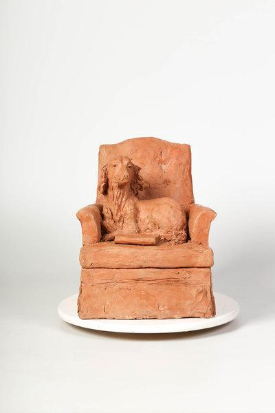 Perro Cartesiano en sofá